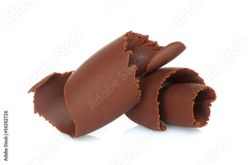 Chocolate shavings on white background .