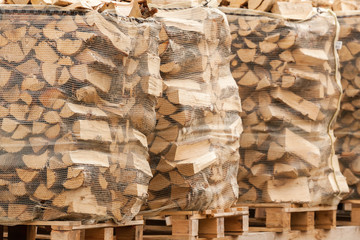 Packed stacks of fire wood laying on palettes