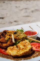 Frittata con pollo croccante e tartina di verdura