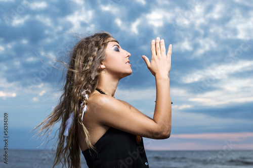 Woman praying to the sky