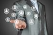 Businessman with hand holding virtual social media buttons.