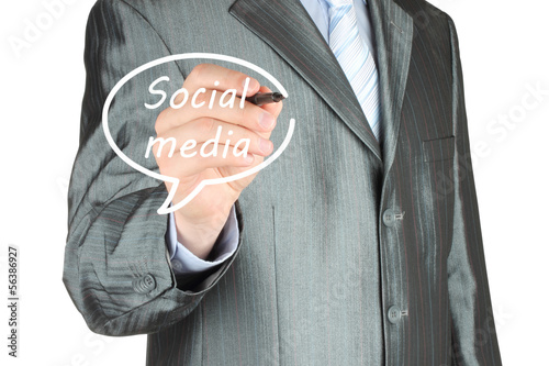 Businessman drawing social media bubble on white background.
