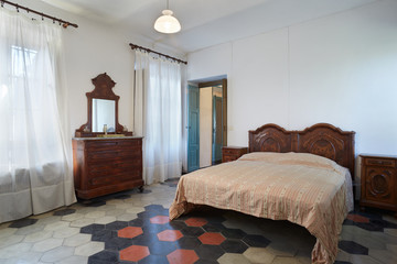 Old bedroom in country house in Italy