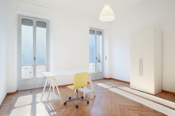Sunny room studio with desk and chair
