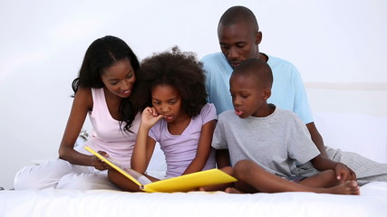 Son reading story to his family