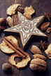 Wooden christmas star and ingredeints for a christmas cake