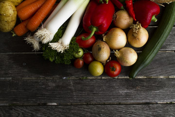 Fresh vegetables on wooden table in garden
