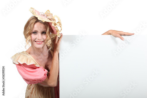 Blank advertising board and woman in fancy dress
