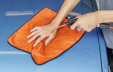 Cleaning Car Using Microfiber Cloth And Air Blower