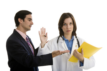 Doctor holding hand up with businessman trying to talk