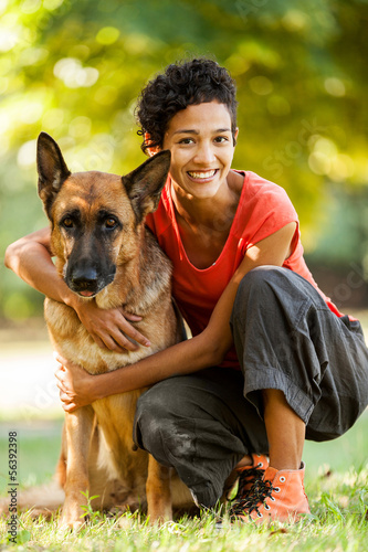 Portrait of woman with german shepherd