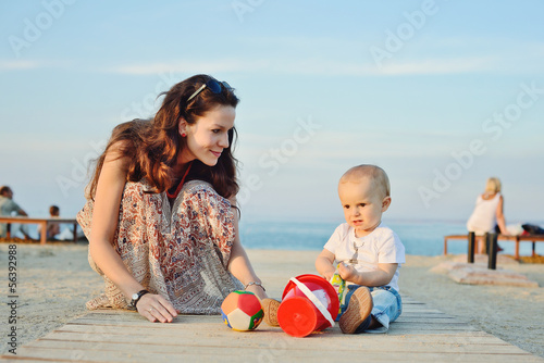 mother and baby son playing toys