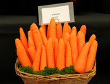 A Display of Fresh Carrots in a Wicker Basket.