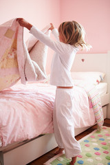 Young Girl Making Her Bed