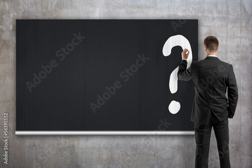 businessman drawing question mark