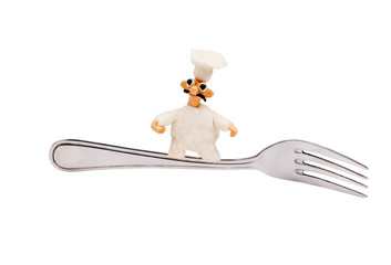 little cheerful chef made of plasticine