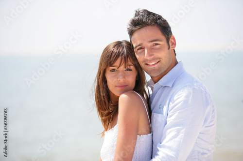 Couple hugging at the sea