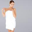 Beautiful woman posing in a white towel