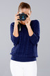 Stylish young woman photographer
