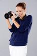 Female photographer assessing her shot