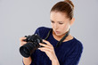 Female photographer checking an image