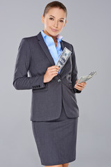 Stylish businesswoman holding dollar bills