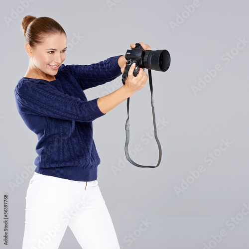 Pretty vivacious young female phoptographer