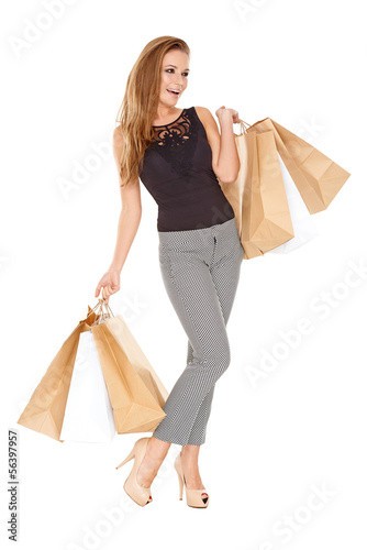 Trendy young woman with shopping bags