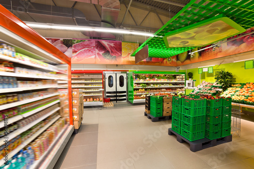 Keuken foto achterwand Boodschappen shelves with products in the supermarket
