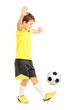 Full length portrait of a boy in sportswear joggling a football