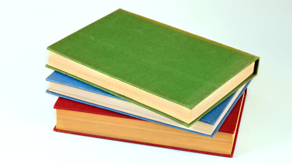 Libros Apilados En Fondo Blanco