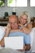Senior couple using at laptop