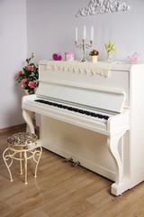 White room with the piano
