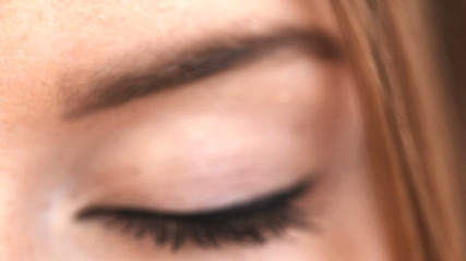 Close up on blonde womans blue eye