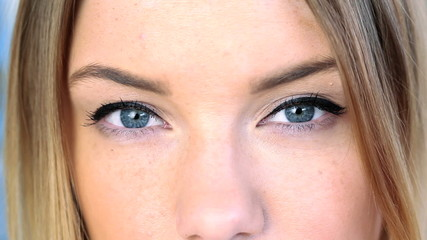 Close up on blonde womans blue eyes