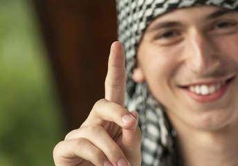 Young muslim man with scarf on head