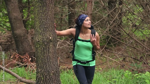 Fit brunette exploring a wooded area