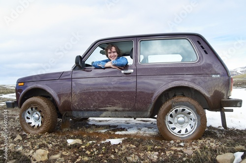 Smiling man in car offroad