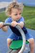 Curly child at seesaw