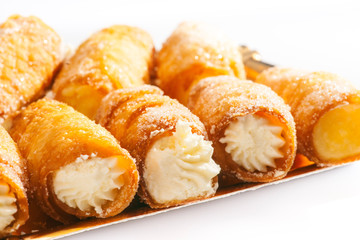 combs and honey pastry filled with cream, golden tray