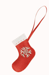 Handmade Christmas decorations: felt Santa boot isolated