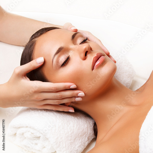 Zdjęcia Face Massage.  Close-up of a Young Woman Getting Spa Treatment.