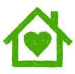 grünes Haus mit Herz