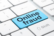 Privacy concept: Online Fraud on computer keyboard background