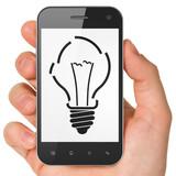 Finance concept: Light Bulb on smartphone