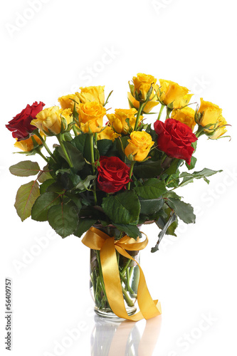 yellow and red roses in a vase