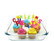 Birthday cupcakes with candles happy birthday in Spanish