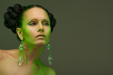 austere beauty portrait in a green glow.