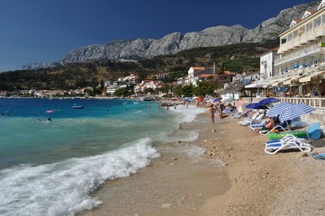 Amazing beach of Podgora with Biokovo mountain in background