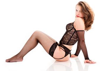 sexy woman in underwear sitting on the floor